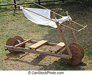 original old stone age car made of wood - funny old stone...