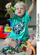Fun Little Boy PLaying with Toys - A cute little boy child...