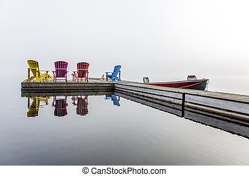 Colorful Muskoka Chairs on a Dock - Colorful Muskoka Chairs...