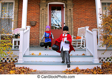 Children in Costumes Trick-or-Treating on Halloween - Two...