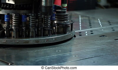 View of sheet metal stamping, close-up - Manufacturing. View...
