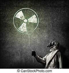 Radioactivity catastrophe - Man in respirator with...