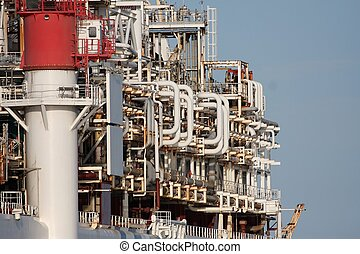 Oil Plant on Ship - Intricate pipes and fittings of an oil...