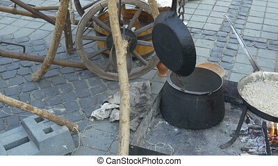 Medieval Cooking Utensils - Pans, pots, barrels hanging...