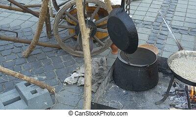 Medieval Cooking Utensils - Pans, pots, barrels hanging...