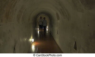 buddhist tunnel candle temple - Asian senior couple walking...