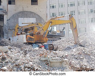 Destroyed building - Old bulldozer Side view Debris from...