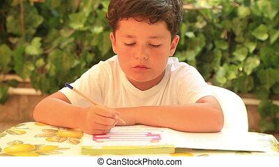 Cute kid doing homework