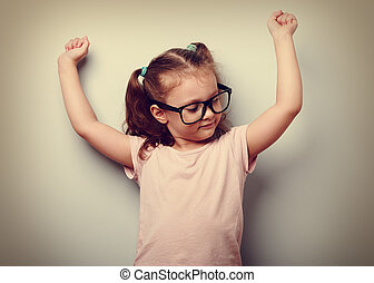 Strong happy successful girl showing muscular. Healthy child...