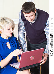 Businesswoman with laptop - Young businesswoman working with...