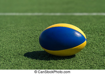 Rugby ball - A rugby ball on a synthetic grass in front of...