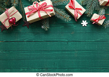 Christmas background with copyspace over rustic green wooden...