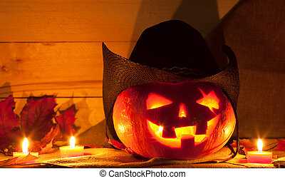 Jack O Lantern in a cowboy hat on the table Pumpkin carved...