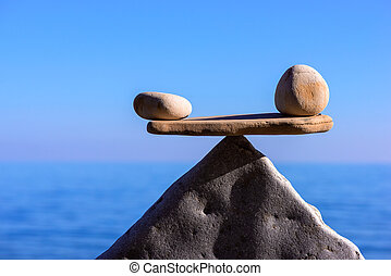 Equality - Symbol of scales is made of pebbles on the...