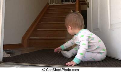 Baby thinking about steps near open - A 4k video made with a...
