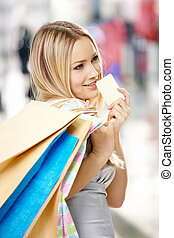 Blonde and a credit card - Portrait of the attractive...