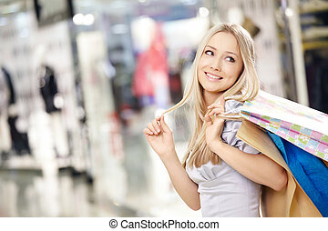 Smiling shopping woman - Attractive smiling blonde on...