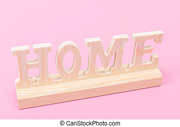 sweet home - lettering home made of wood against pink...