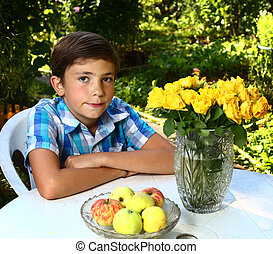 boy with roses on blossoming garden background - preteen...