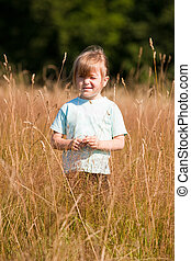 A child in the field. Close-up.
