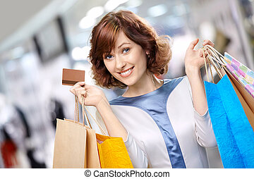 Portrait of shopaholic - Portrait of the young beautiful...