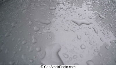 Rain on freshly waxed truck hood - Rain falling on freshly...