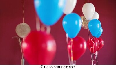 Bunch Of Colourful Balloons On Dark Red Background
