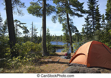 Campsite overlooking Boundary Waters lake in Minnesota - A...