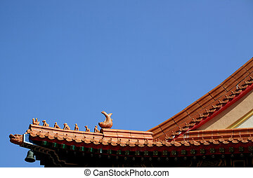 The roof of chinese temple, with statue