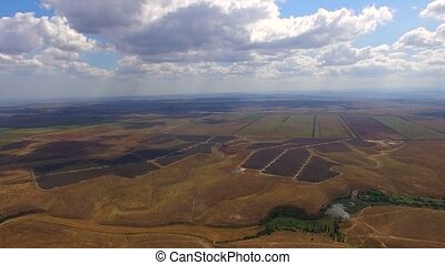 Solar Power Stations Among Multi Colored Agricultural Fields...