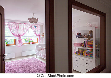 View from warm corridor to bright baby room