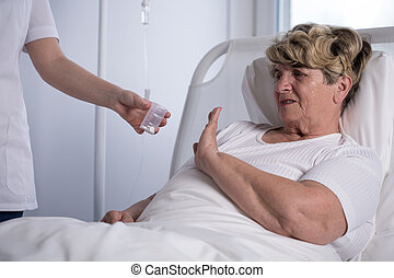 Refusing to take medicine - Elderly woman is refusing to...