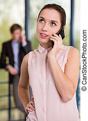 Pretty young businesswoman talking on the phone
