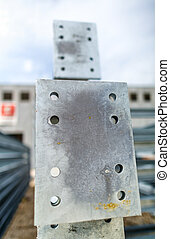 Steel girders in outdoor warehouse.