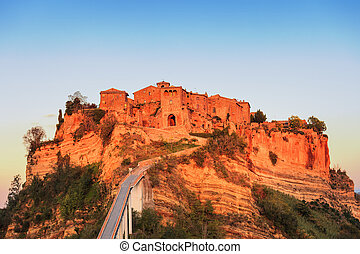 Civita di Bagnoregio landmark, bridge view on sunset Italy -...