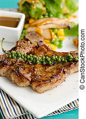 grilled t-bone steak and vegetables