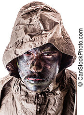Soldier with raincoat - a soldier wearing a poncho or...