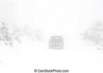Heavy snow on the road - heavy snow on the road in the foggy...