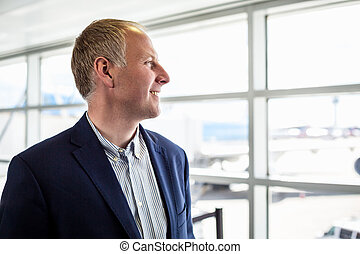 Businessman happy to travel by plane