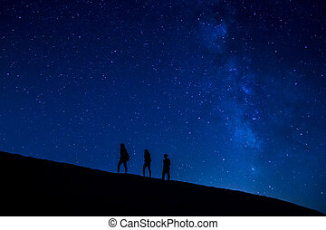 Treking at night - People trekking at night with stars and...