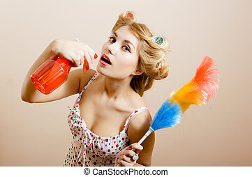 Housewife - Desperate housewife posing with spray in right...