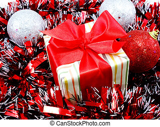 gift box present with red ribbon decorations with red and...