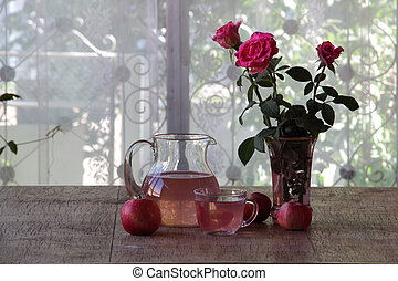 Apple compote in a transparent jug and roses - Bouquet from...