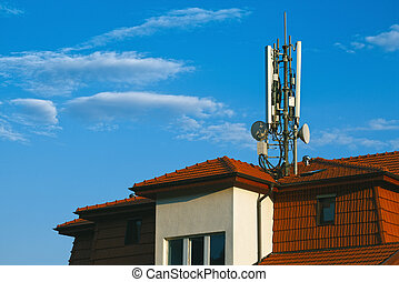 Living building with GSM antennas on roof isolated on blue...