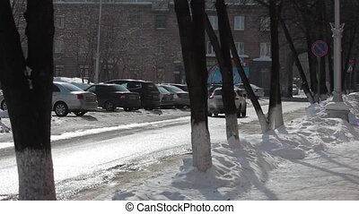 winter Parking lot of cars covered with snow by a passing...