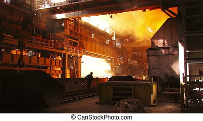 Work metallurgical plant - Hot steel pouring in steel plant