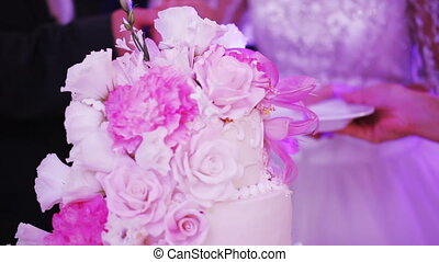 Cutting wedding cake - Couple newlyweds cut beautiful...