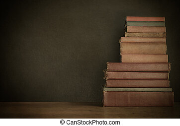 Book Stack on Desk with Chalkboard Background - Vintage...
