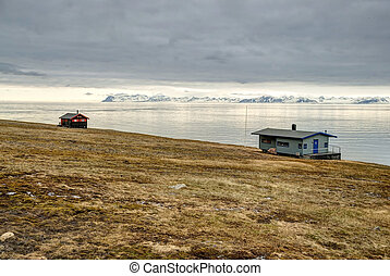 Lonely house at the coast near Longyearbyen, Svalbard,...