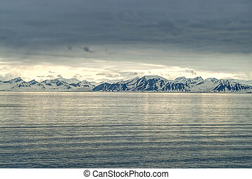 Snowy mountains by the ocean, Arctic - Landscape of snowy...